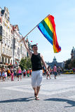 Prague Pride 2012. Gay flag bearer waving his rainbow flag in the centre of Prague (Czech Republic) during the Prague Pride 2012 Royalty Free Stock Photography