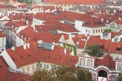 Prague röda tak Royaltyfria Bilder