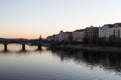 Prague River and Bridge During Sunset royalty free stock image