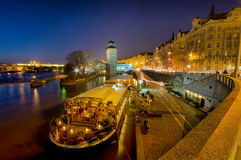 Prague and River Vltava by night. Resturant boat on the River Vltava in Prague on a summer evening Stock Photo