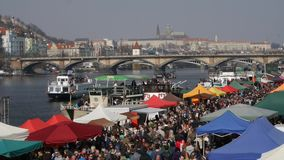Prague's traditional markets - shipping on the river Vltava - Prague Castle in the background stock video footage