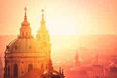 Prague Saint Nicholas Church on Misty Morning Stock Photo
