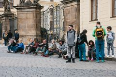 Prague, September 21, 2017: Different people, tourists and locals rest on the city street, communicate Someone eats food. And drinks traditional Czech beer Royalty Free Stock Photography