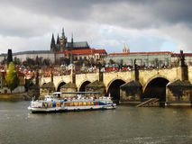 Prague ship. The ship in the Prague with the Charles bridge and the government on the background Stock Images