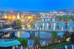Prague sikt av broar över den Vltava floden i afton Royaltyfria Bilder