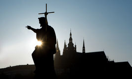 Prague - silhouette of Saint John the Baptist statue from Charle Royalty Free Stock Images