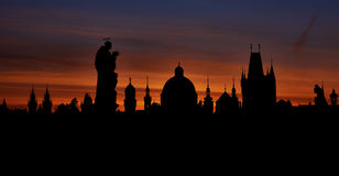 Prague silhouettes from Charles Bridge before dawn Stock Photography