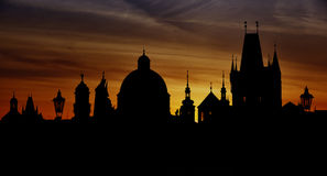 Prague silhouettes from Charles Bridge before dawn Stock Photos