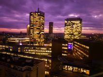 Prague skyscrapers in blue hour with purple sky. Modern office architecture. Prague skyscrapers in blue hour with purple sky. Modern building architecture after Stock Images