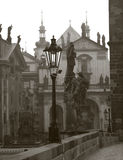 Prague - statue of Charles and churches in morning Royalty Free Stock Photo