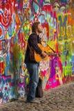 Prague Street Busker Performing Beatles Songs at John Lennon Wal Royalty Free Stock Photos