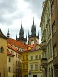 Prague street and cathedral. Street in prague with charles square cathedral in background Royalty Free Stock Photography