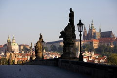 Prague sunrise scenery. Morning view from Charles Bridge to Lesser Town and Prague castle Royalty Free Stock Photo