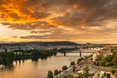 Prague sunset over Vltava river from above with orange sky. Royalty Free Stock Photos