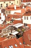 Prague tile roofs. View of colorful roofs in Old Town Square area of Prague,with nice restaurant in the middle Stock Photo