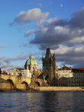 Prague towers and Charles bridge. In morning golden light Stock Images