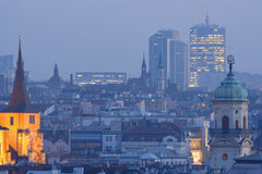 Prague towers at dusk. Prague - towers of the old town and office highrises at dusk Royalty Free Stock Photos