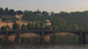 Prague Tram Passing the Bridge over Vltava River. In Early Morning, Public Transportation in Czech Republic Capital stock video