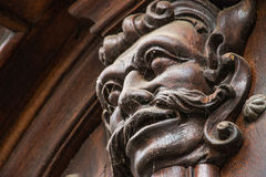 Prague - a troll's head door ornament royalty free stock image