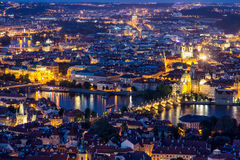 Prague at twilight blue hour, view of Charles Bridge on Vltava with Mala Strana and Old Town Stock Photo