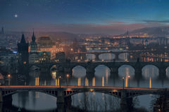 Prague at Twilight, view of Bridges. Stunning scenery of Prague bridges with glowing streetlights at starry night Royalty Free Stock Photography