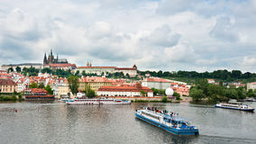 Prague view from bridge. View from bridge over Prague and boats with tourists Royalty Free Stock Photos