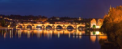 Prague, view of illuminated Charles bridge Karluv most with reflection in the water, night scenic cityscape, Czech Republic royalty free stock images
