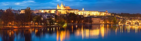 Prague, view of illuminated Charles bridge Karluv most with reflection in the water, night scenic cityscape, Czech Republic stock images