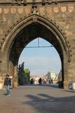 Prague view of Old Town Stare Mesto through the arch of the Malostransky tower of Charles Bridge from Mala Strana royalty free stock photography