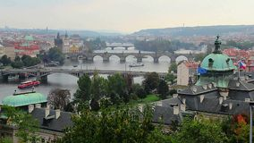 Prague view, river ships, bridges transport vehicles, flags wave. Stock footage stock video footage