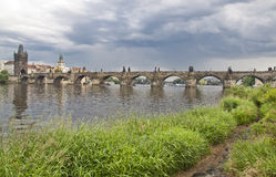 Prague. View from Vltava to the Charles Bridge and the Old Town. The famous Charles Bridge The Old Town Bridge Tower started in 1357 under the auspices of King Royalty Free Stock Photo