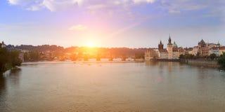 Prague -  Vltava Embankment and Charles Bridge, the Czech Republic. Sunset Royalty Free Stock Image