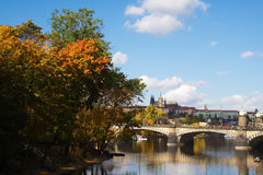 Pragues river in autumn. View of Pragues river in autumn and the castle in the distance Royalty Free Stock Image