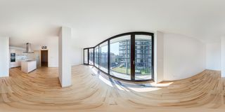 PRAHA, Czech Republic - JULY 21, 2014: Panorama of modern white empty loft apartment interior living hall room, full 360 seamless stock photography