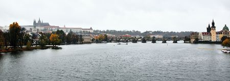 Praha, Czech republic - October 28, 2018: autumnal Hradcany and Karluv most charles bridge over Vltava river viewed from Most Legi stock photography