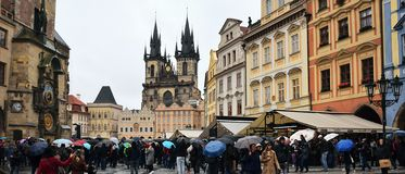 Praha, Czech republic - October 28, 2018: Staromestske namesti square with people under umbrellas in rainy day of centenary of th. E founding of the stock image