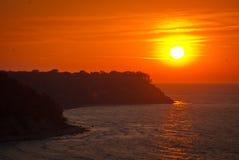 Praia bonita do por do sol do mar Imagens de Stock Royalty Free