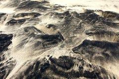 Praia branca e preta da areia Fotografia de Stock Royalty Free
