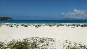 Praia com banhista Stock Images