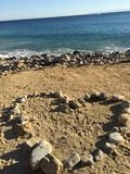 Praia completamente das pedras Fotografia de Stock Royalty Free