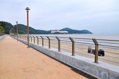 Praia da areia do preto de Macau Foto de Stock