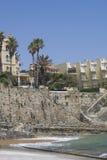 Praia da Azarujinha, beach in Estoril, portugal. hill, houses, stairs near ocean Stock Photos