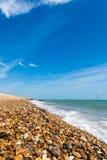 Praia da costa da telha Imagens de Stock