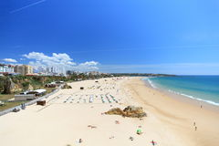 Praia da Rocha on the Algarve in Portugal. Located in the central region of the Algarve in Portugal is the popular tourist resort of Praia da Rocha. Over the royalty free stock image
