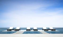 A praia da sala de estar e a cama e o mar exteriores de dia veem o fundo no verão Imagens de Stock