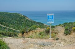 Praia Das Adegas beach near Odeceixe, Portugal. Sign of Adegas Naturist beach near Odeceixe, Portugal stock images