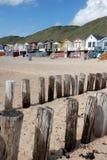Praia das casas de verão do quebra-mar Imagem de Stock Royalty Free