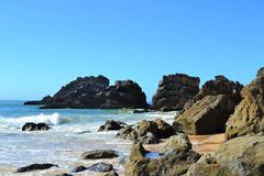 Praia de Adraga. The Praia de Adraga is regarded as one of the best beaches of Portugal mainly due to the stunning scenery of cliffs, jagged rock out crops and Royalty Free Stock Image