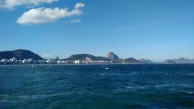Praia de Copacabana e Pão de Açucar Photographie stock