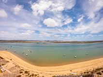Praia De Faro, Algarve, Portugal. Aerial view on coast of ocean and beach. Boats on water, drone view stock photography